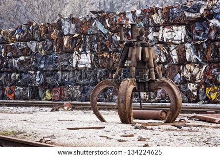 Industrial claw, used for loading stone, ores, wood, scrap metal in industry - stock photo