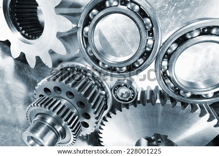 industrial cogwheels and ball-bearing arrangement, titanium and steel - stock photo