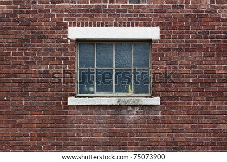 Industrial Color Brick Wall with Blue Window - stock photo