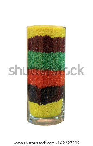 Industrial colored plastic pellets in a glass - stock photo