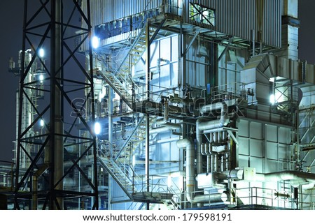 Industrial complex at night - stock photo