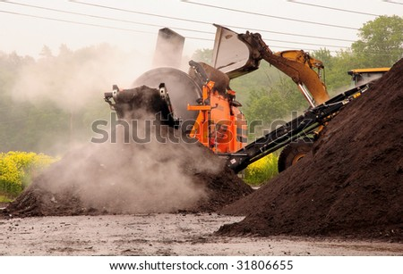 Industrial compost handling - stock photo