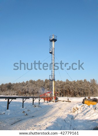 Industrial construction and mechanism. Work of oil industry. Mounting of pipework in wild Siberian taiga. - stock photo