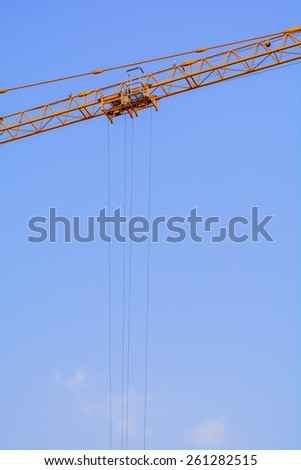 Industrial construction cranes cable on the blue sky background - stock photo