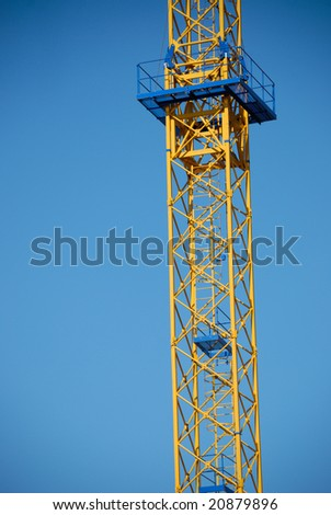 Industrial construction in the form of a tower with a ladder