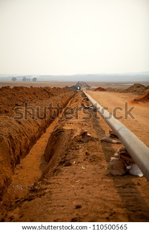 Industrial construction oil and gas or water and sewage plumbing pipeline outside on remote site location