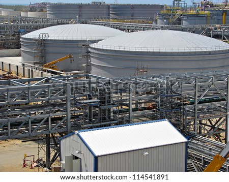 Industrial construction site with storage tanks - stock photo