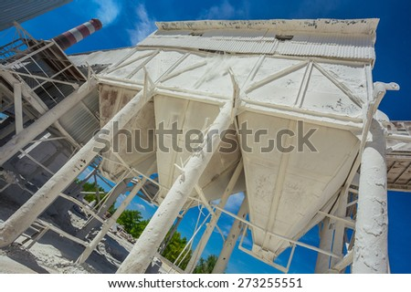 industrial container at the plant for the production of building mixtures - stock photo