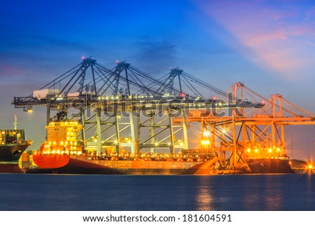 Industrial Container Cargo freight ship with working at twilight - stock photo