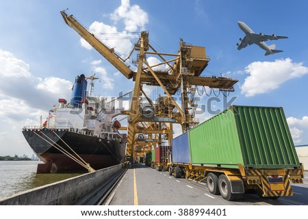 Industrial Container Cargo freight ship with working crane bridge in shipyard at port  - stock photo