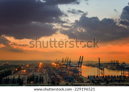 Industrial Container Cargo freight ship  with working crane bridge in shipyard at sunset - stock photo