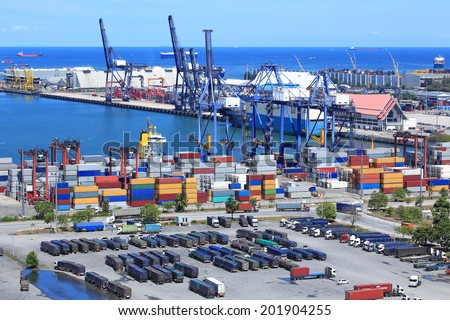 Industrial Container Cargo freight ship with working crane bridge in shipyard with truck top view  - stock photo