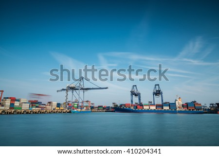 Industrial Container Cargo freight shipping by crane Logistic Import Export  in shipyard at twilight - stock photo