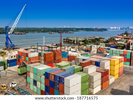 Industrial Container Cargo in harbor beside river - stock photo