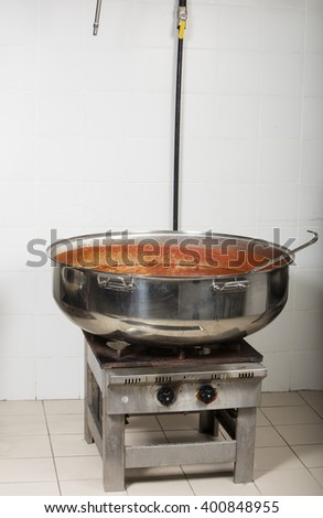 industrial cooking restaurant kitchen equipment- cooking beans - stock photo