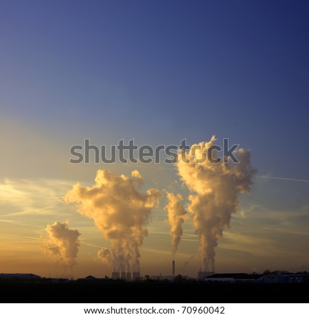 industrial cooling towers at dusk - stock photo