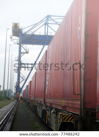 Industrial crane and train in Fog - stock photo