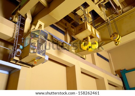 Industrial crane hook in a building  - stock photo