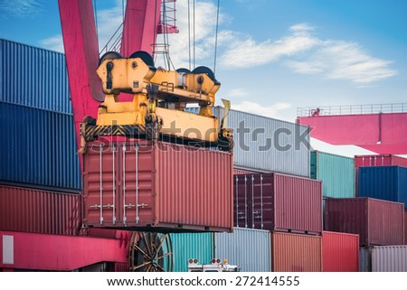 industrial crane loading and unloading and cargo containers closeup ,  modern logistics background