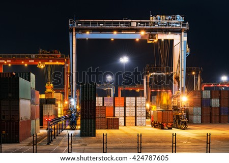 Industrial crane loading Containers in a Cargo freight ship - stock photo