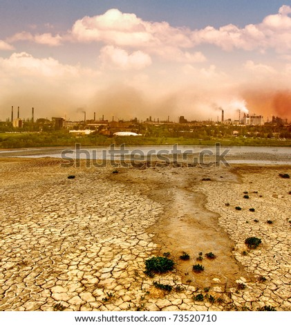 Industrial destruction. Smoke and smog from a manufacturing plant. Environmental pollution of the industrial city, smoking chimneys of factories. - stock photo
