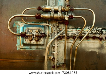Industrial detail of an old rusty engine - stock photo