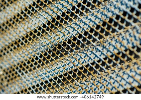 Industrial electrical high voltage switchboard rusty metal ventilation grille grid covering door surface texture close up details background image - stock photo