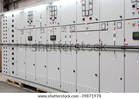 industrial electrical switch panel in factory - stock photo