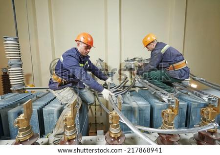 Industrial electrician lineman repairman workers team - stock photo