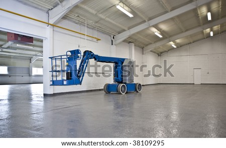 industrial elevated crane platform in empty warehouse - stock photo