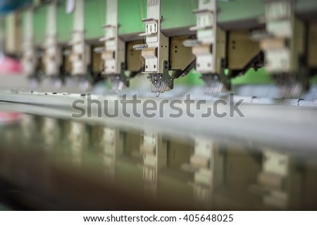 industrial embroidery machine - stock photo