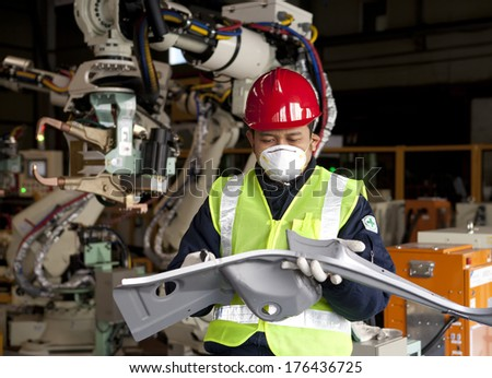 Industrial engineer checking quality metal production - stock photo