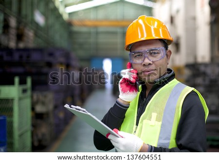 Industrial engineer on the phone - stock photo