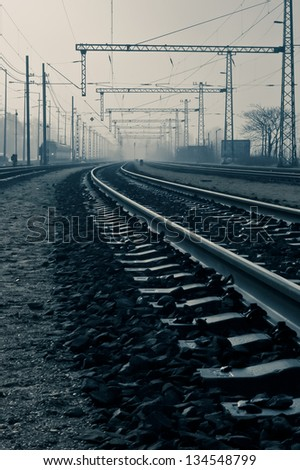 Industrial environment long arched railways in the suburbs, steampunk effect - stock photo