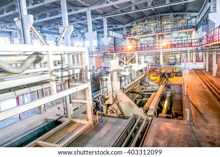 industrial equipment at the factory in large  production hall
