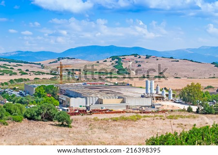 industrial factory in the countryside - stock photo