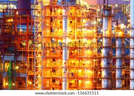 Industrial factory with night illumination - stock photo