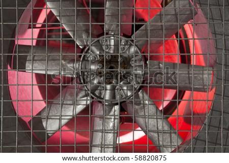 Industrial fan behind a metal grate, - stock photo