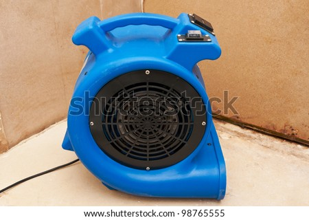 Industrial fan to remove water damage. - stock photo