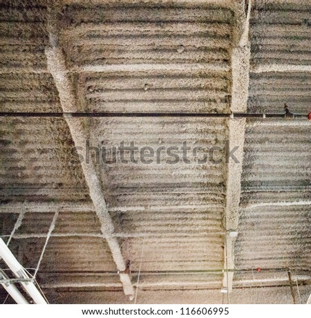 Industrial fire retardant insulation installed in the sloping ceiling - stock photo