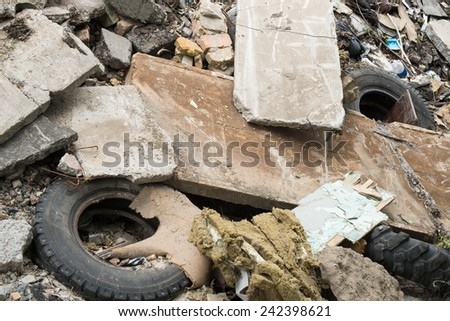 Industrial garbage. Heap of the damaged concrete blocks, old tires and other rubbish - stock photo