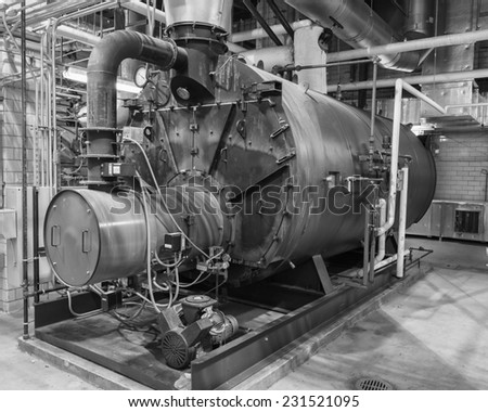 Industrial gas fired boiler.  Typical installation with piping, valves, breeching, and air compressor. - stock photo