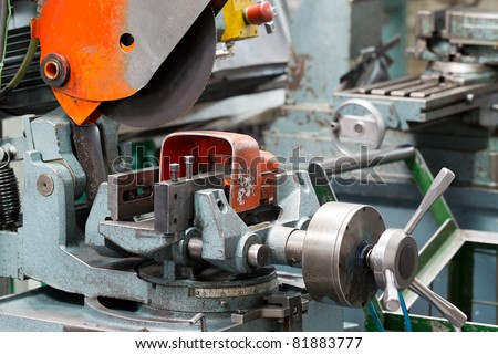 INDUSTRIAL GRADE CUTTING MACHINE USED TO CUT CUT LARGE COMPONENTS  - stock photo