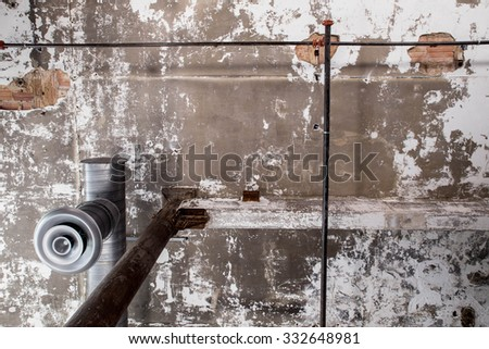 industrial grunge image ceiling with pipes and peeling paint - stock photo