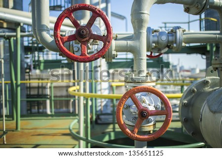 Industrial hand valve in petrochemical plant. - stock photo