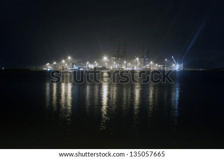 Industrial harbor at Kochi at night, Kerala, India - stock photo