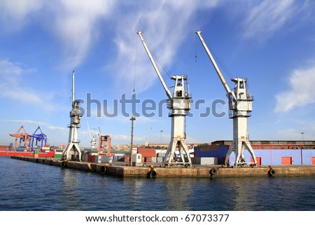 Industrial harbor with large cargo cranes - stock photo