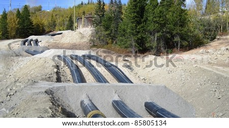 Industrial HDPE pipe laid on ground - stock photo