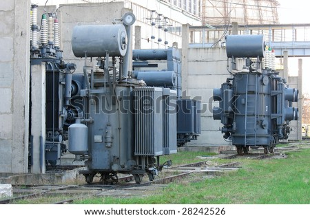 Industrial high voltage converter at a power plant - stock photo