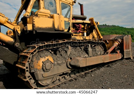 Industrial image of construction equipment. Bulldozer shown at a coal mine. - stock photo